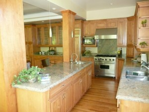 Poorly designed kitchen from Feng Shui kitchen design - Straight line and back to doorway.