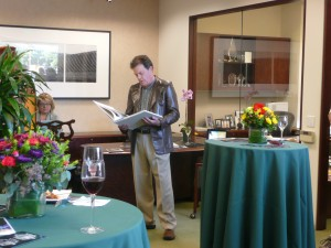 Photographer Robert Buelteman reading a quote from his pictorial book at First Republic's Palo Alto Branch.